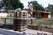 A construction team used textile blocks to build the walls of the Frank Lloyd Wright Usonian House at Florida Southern College.