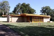 A view from the street of the almost finished Frank Lloyd Wright Usonian House at Florida Southern College.