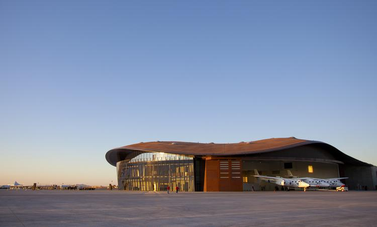 Virgin Galactic has pushed its anticipated launch date back six months, and the delay could cost the state millions, according to New Mexico Spaceport Authority officials. Pictured is Spaceport America.