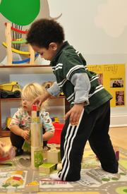 Diego Scotland plays with eco-friendly blocks at Eco Baby Daycare in Troy.
