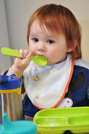 Declan Mulligan eats from Bisphenol A or BPA-free dishware at Eco Baby Daycare in Troy. The dishes are made from recycled milk cartons.