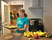 Eco Baby Daycare owner Robyn Scotland with a tray of her whole grain corn muffins.