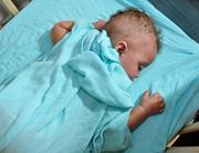 Julius Dunckle naps on  aden + anais sheets made from bamboo fiber muslin at Eco Baby Daycare in Troy.
