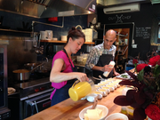 Chefs Naomi Pomeroy and Jehangir Mehta pour butternut squash veloute at a gluten-free lunch at Beast.