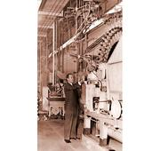 American Canning Company plant manager Frank Grote Jr. inspecting the line at the company's factory in Denver.
