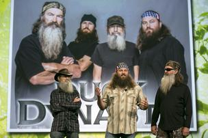 Television personalities Si Robertson, left to right, Willie Robertson and Phil Robertson from A&E Television Networks's Duck Dynasty television show speak at the National Cable and Telecommunications Association (NCTA) Cable Show in Washington, D.C., on June 10, 2013.