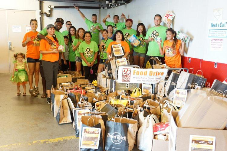 Christina Laney Wycheck is pictured with some 20 friends and family members who volunteered last year for her annual neighborhood food drive to benefit the Hawaii Foodbank, which has asked Laney Wycheck to share her procedure so that others can replicate it in their neighborhoods.