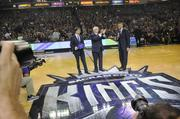 Sacramento Kings lead investment group owner Vivek Ranadive takes the court, along with NBA commissioner David Stern, applauding, and Mayor Kevin Johnson.