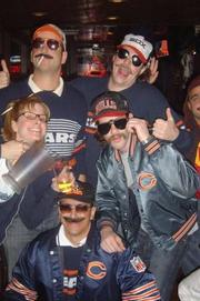 To re-create Da' Bears superfans from the old Saturday Night Live sketches, all it takes is a pile of throwback Chicago Bears gear and a trip to a dollar store for fake mustaches and cheap sunglasses.