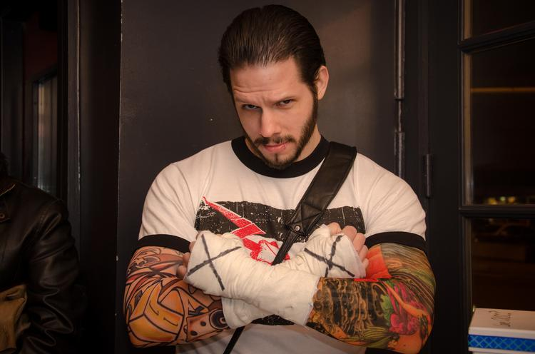 CM Punk is one of today's most popular WWE wrestlers. While gathering up his clothes and various accessories isn't all that hard, you'll need more than a day or two to pull off his musculature.