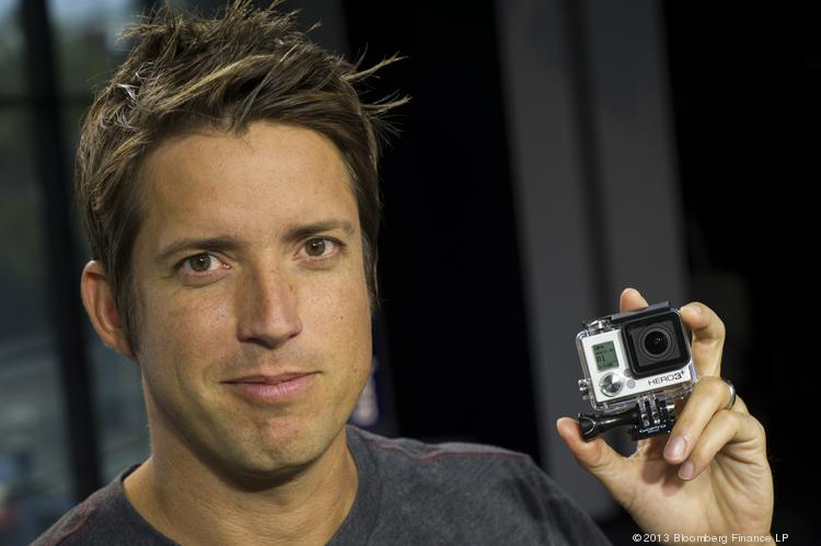 """Nicholas """"Nick"""" Woodman, founder and CEO of GoPro, holds a GoPro Hero 3+ camera. The company filed a secret IPO today."""