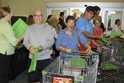 Mims Cushing, center, is happy to be one of the first customers to enter the new Sawgrass Village Publix Thursday in Ponte Vedra Beach.