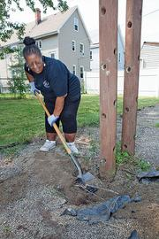 Andrea Mujahid-Moore, of HUD, volunteers at the Day of Caring sponsored by the United Way of Buffalo & Erie County, which allocates 11.8 percent of its budget to overhead costs.
