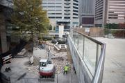 The demolition is part of a plan to increase foot traffic on Pratt Street.