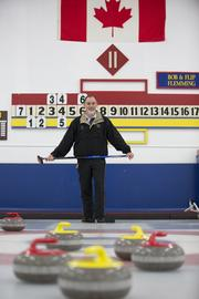 """Laux on the """"sheet"""" at Kettle Moraine Curling Club. Click here for story."""