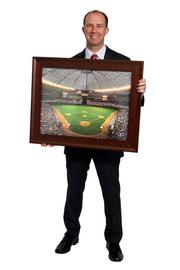 Matthew Bates  I brought a picture of the Astrodome. I was raised in a small town, and we would drive to Houston to come watch the Astros play. When I think of Houston, I think of the Astrodome.