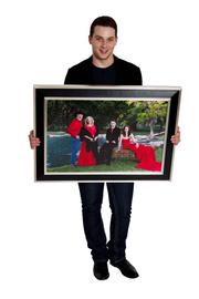 Jonathan Blake Tinkle  The photo of my family all wearing red shows how we are a strong, close unit yet we are all unique. My sister, Amanda, is wearing my Rose Gown, which was the signature piece in the very first Jonathan Blake collection.
