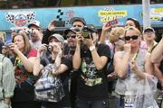 Fans at Phoenix International Raceway gather to get pictures and autographs of their favorite drivers.