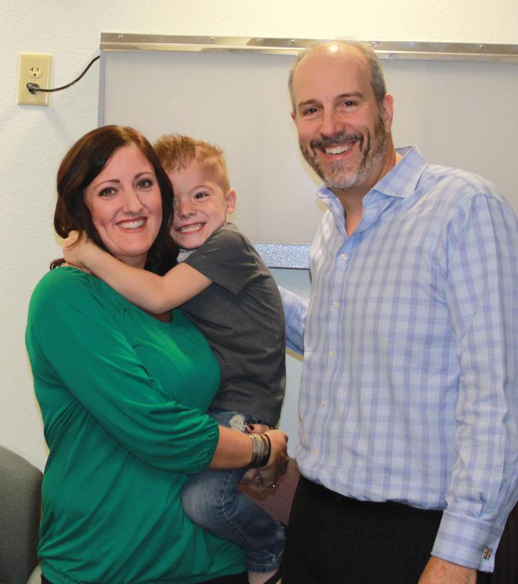 Stacey Davis and her son, Cash, meet with Dr. David Notrica for a checkup.