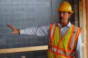 Wayne Bamburger, project manager for Metrolina Builders Inc., leads visitors through the Fort Mill project.