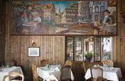 The dining room mural offers up a German street scene. Click here for story.