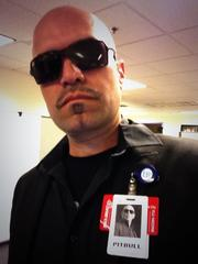 An employee in the Crown Center offices of Children's Mercy Hospitals and Clinics does his best impression of rapper Pitbull, including an official nametag.