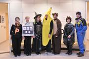 City of Lenexa staff, including one particularly slippery character, pose for a photo with their Halloween costumes.