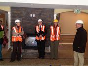 Denver City Councilwoman Peggy Lehmann, Dennis Van Wynsberghe, Brenda Hunt and Mike Longfellow at the main-floor fireplace (there are eight of them in the complex).