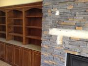 Fireplace and shelves in library community room.