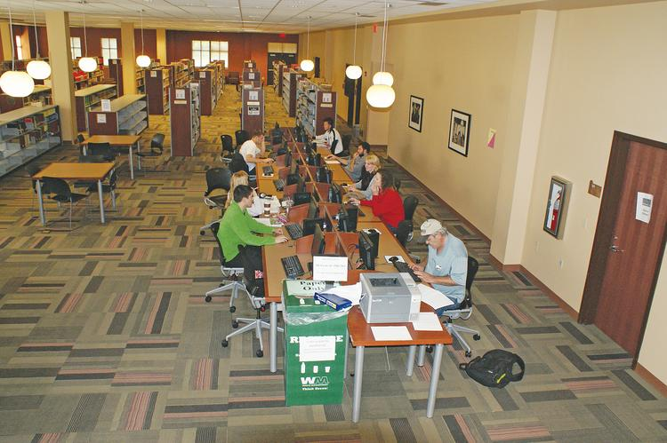 Newman University's Dugan Library & Conference Center is a popular gathering place for students. This computer area in the library was busy Wednesday with students working on various projects.