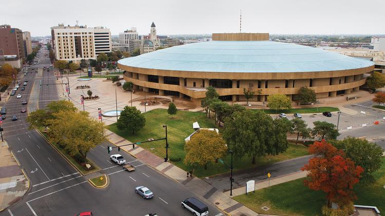 Wichita developer George Laham envisions a Douglas Avenue promenade with a meandering row of shops and restaurants buffered from traffic by gardens and fountains from Main Street to the river, including a prominent entrance into a state of the art Century II Performing Arts and Convention Center.