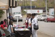 Crista Hardaway, middle, and Brandi Newton, right, talk with Robyn Hyden, seated, at the health fair which was put  as part of the Revive Ensley project. Hyden is with Alabama Arise Citizens's Police Project. She was talking with them about the Affordable Care Act.