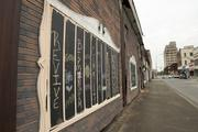 Street art decorates buildings along 19th Street as part of Revive Ensley.