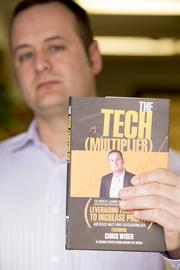 """To help build his business, Wiser wrote a book for small business owners in 2009, and last year contributed a chapter to """"The Tech (Multiplier)."""" Click here for story."""