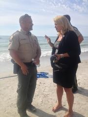 State Rep. Kathleen Peters speaks with a representative from the Florida Fish and Wildlife Conservation Commission.