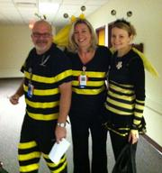 Greg Hugeback (from left), Lisa Hensley Blanchard and Jamie Menown, nurses at Children's Mercy Hospitals and Clinics, have been buzzing around today.