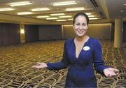 Catherine Johns shows the recently renovated Kou Ballroom at the Hyatt Regency Waikiki Beach Resort & Spa, which she hopes is packed this holiday season.
