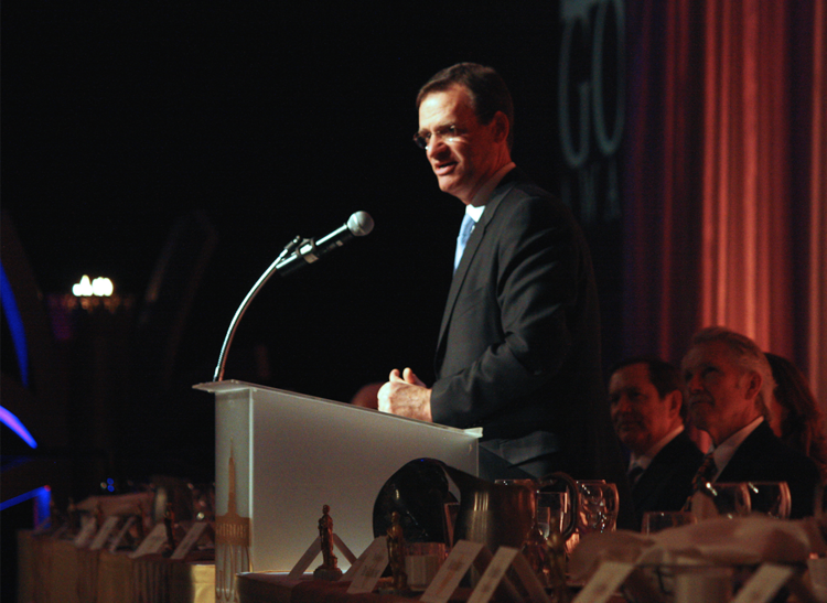 Mark Ganz, president and CEO of Cambia Health Solutions, accepting a 2013 Governors' Gold Award.