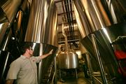 Joey Redner, owner, in Brew House II with fermenting vessels.