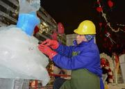 Ice sculpture Xiang Ji Wei works inside Gaylord Texan's nine degree tent which will house their ICE Nutcracker show.