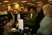 """Hubert Crouch signs copies of """"Cried for No One"""" for guests. Pictured (from left) Hubert Crouch, Alex Buchanan, Chip Hickerson, Larry Pass and Stryker Warren."""