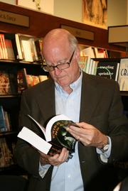 """Alex Buchanan enjoys reading an excerpt from """"Cried for No One"""" at author Hubert Crouch's book signing."""