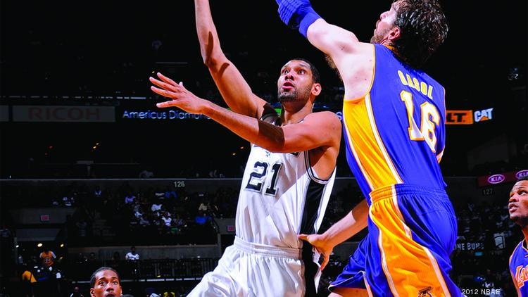 File photo of San Antonio Spurs forward Tim Duncan schooling Pau Gasol of the Los Angeles Lakers. Forbes' Tom Van Riper says it is bad news that the Spurs, who own the best record in the NBA, are contending for another title.
