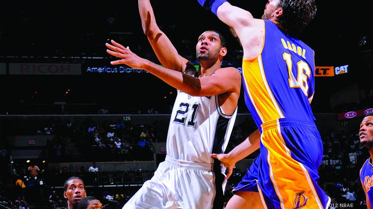 Spurs forward Tim Duncan scores on Pau Gasol in this file photo. The San Antonio team recently ranked No. 1 in fan loyalty.