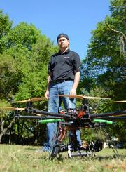 Jeff Atkisson with a helicopter drone used by his company.