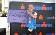 He carried a courage flag across the finish line in tribute to his niece, Blair, and other children with illness.