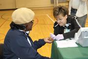 A woman gets screened for diabetes at the Johnston YMCA.