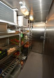 """Walk-in refrigerator and walk-in freezer on board the 163-foot yacht """"Inevitable."""""""