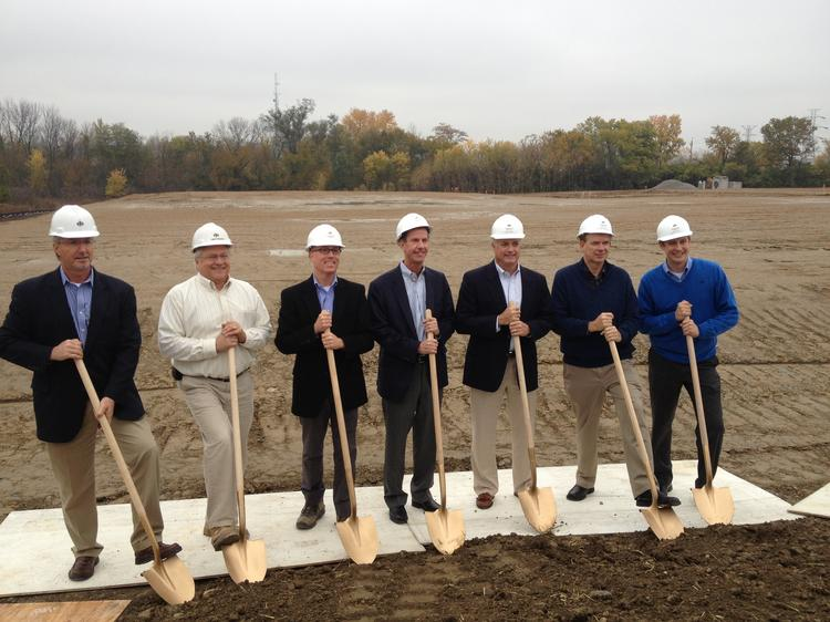 From left, Joel Tiberghien, Mark Mueller and Tim McElroy of Design Build Solutions,  Dick Siess of Industrial Tube & Steel, Tom Torback of DBS, and Bob Snyder and Damon Gaynor of ITS break ground at the site of the new facility.