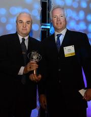 Michael Long, CIO at the Georgia Department  of Revenue, left, winner in the non-profit /public sector category, left; and Greg Frankenfield, CEO of Magenic.